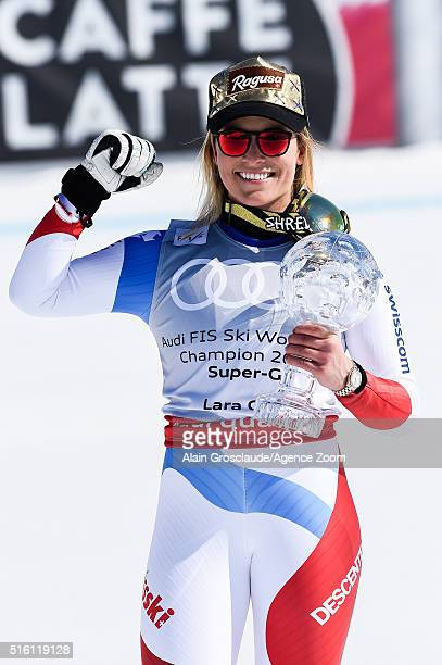 Lara Gut of Switzerland wins the globe in the overall standings during the Audi FIS Alpine Ski World Cup Finals Men's and Women's SuperG on March 17...