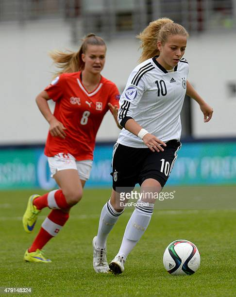 Lara Jenzer of Switzerland chases after Jenny Hipp of Germany during the UEFA European Women's Under17 Championship semi final between U17...