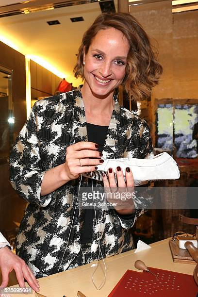 Lara Joy Koerner and needlewoman Oriana during the TOD'S 'The art of leather' party on April 28 2016 in Munich Germany