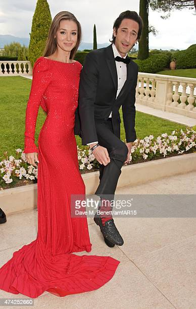 Lara Leito and actor Adrien Brody arrive at amfAR's 22nd Cinema Against AIDS Gala Presented By Bold Films And Harry Winston at Hotel du CapEdenRoc on...
