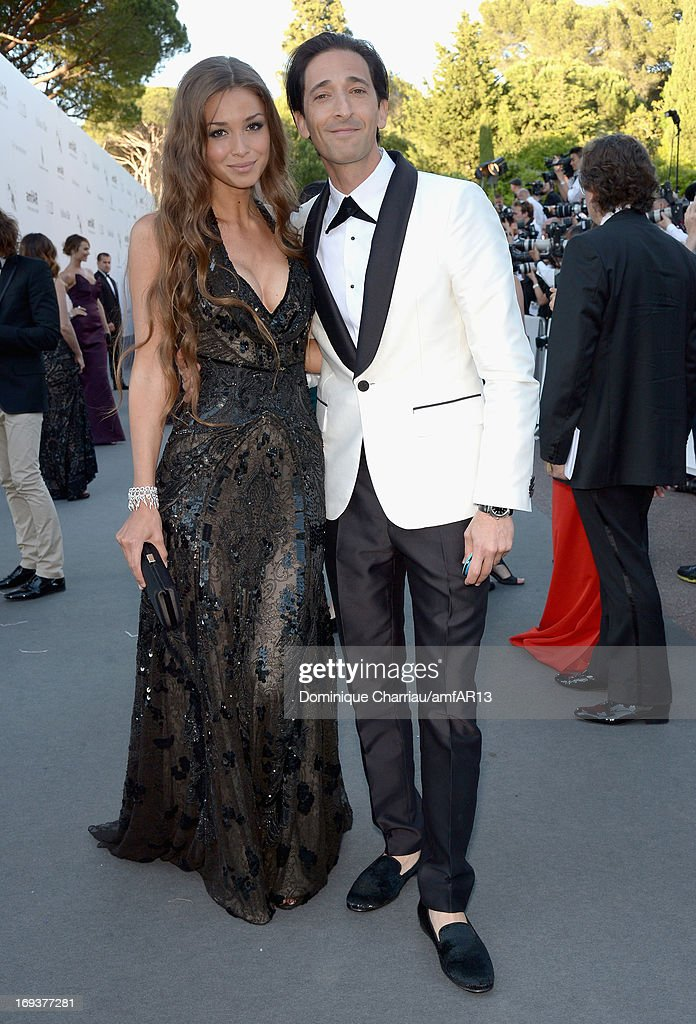 Lara Lieto (L) and actor Adrien Brody attend amfAR's 20th Annual Cinema Against AIDS during The 66th Annual Cannes Film Festival at Hotel du Cap-Eden-Roc on May 23, 2013 in Cap d'Antibes, France.