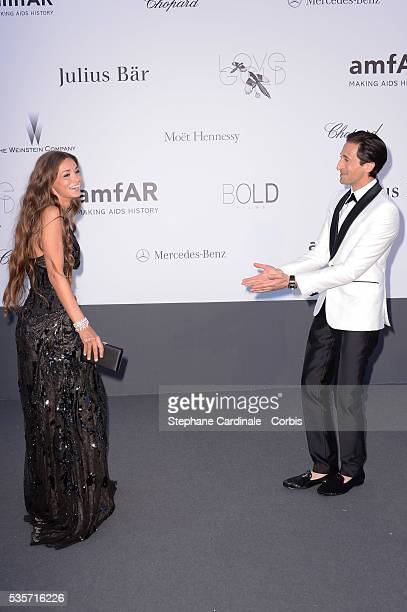 Lara Leito and Adrien Brody attend amfAR's 20th Annual Cinema Against AIDS during the 66th Cannes International Film Festival