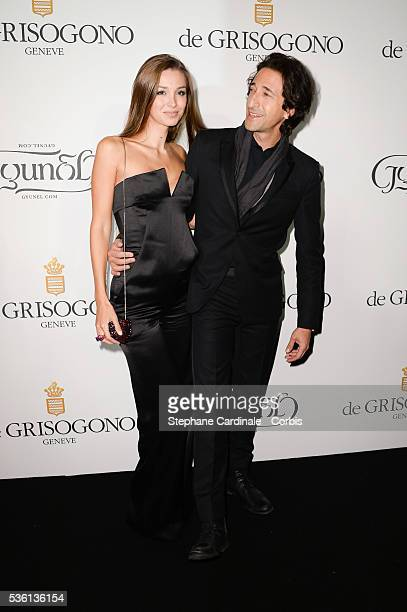 Lara Leito and Adrien Brody attends at the De Grisogono 'Divine In Cannes' Dinner Party at Hotel du CapEdenRoc during the 68th Cannes Film Festival