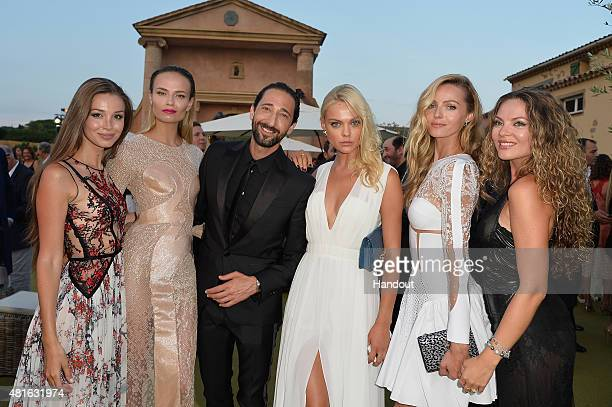 Lara Leito Natasha Poly Adrian Brody Emily Senko and Valentina Zeylaeva attend a cocktail reception during The Leonardo DiCaprio Foundation 2nd...