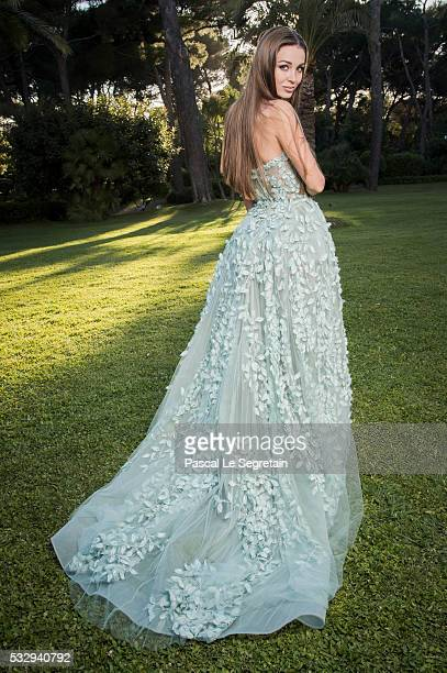 Lara Leito poses for photographs at the amfAR's 23rd Cinema Against AIDS Gala at Hotel du CapEdenRoc on May 19 2016 in Cap d'Antibes France