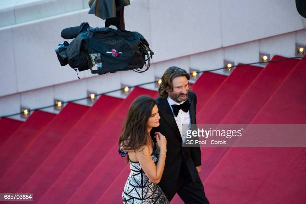 Lara Micheli and Frederic Beigbeder attend the 'Okja' premiere during the 70th annual Cannes Film Festival at Palais des Festivals on May 19 2017 in...
