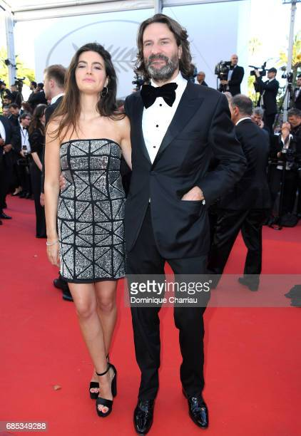 Lara Micheli and Frederic Beigbeder attend the 'Okja' screening during the 70th annual Cannes Film Festival at Palais des Festivals on May 19 2017 in...