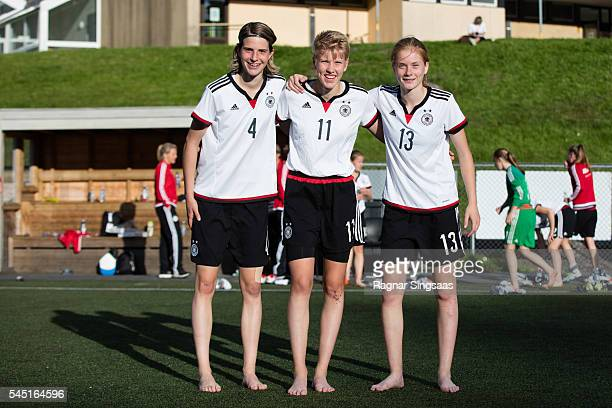 Lara Schmidt of Germany Paulina Krumbiegel of Germany and Sjoeke Nusken of Germany pose for photographs after the Nordic Cup game between U16 Girl's...