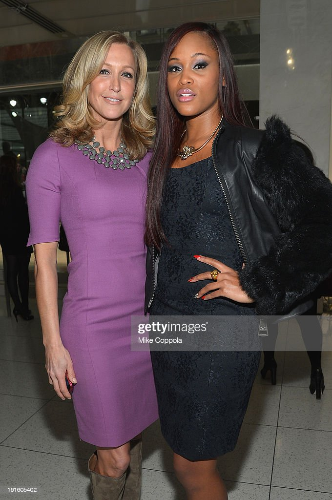 Lara Spencer (L) and singer Eve pose at the Elie Tahari Fall 2013 fashion show presentation during Mercedes-Benz Fashion Week at The Studio at Lincoln Center on February 12, 2013 in New York City.