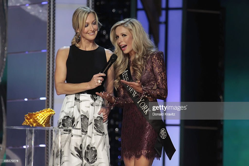 <a gi-track='captionPersonalityLinkClicked' href=/galleries/search?phrase=Lara+Spencer+-+Journalist&family=editorial&specificpeople=240321 ng-click='$event.stopPropagation()'>Lara Spencer</a>, host of Miss America Competition helps <a gi-track='captionPersonalityLinkClicked' href=/galleries/search?phrase=Kira+Kazantsev&family=editorial&specificpeople=12505447 ng-click='$event.stopPropagation()'>Kira Kazantsev</a> a ball with a judges question at Atlantic City Boardwalk Hall on September 14, 2014 in Atlantic City, New Jersey.