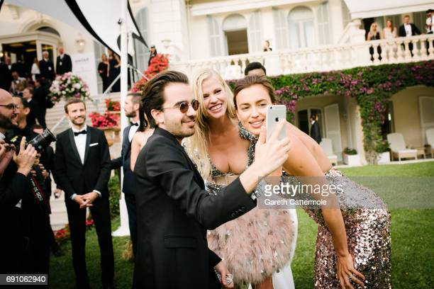 Lara Stone and Irina Shayk attend the amfAR Gala Cannes 2017 at Hotel du CapEdenRoc on May 25 2017 in Cap d'Antibes France
