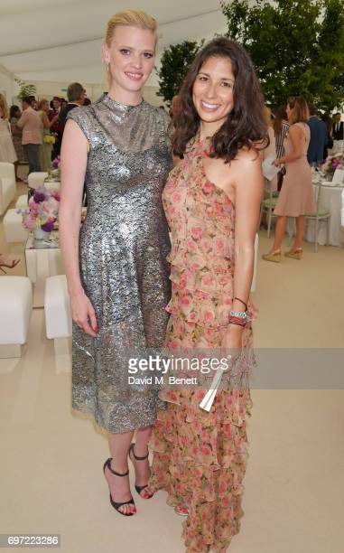 Lara Stone and Jasmine Hemsley attend the Cartier Queen's Cup Polo final at Guards Polo Club on June 18 2017 in Egham England