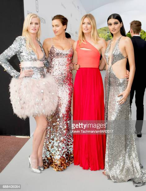 Lara Stone Irina Shayk Doutzen Kroe and Neelam Gill arrive at the amfAR Gala Cannes 2017 at Hotel du CapEdenRoc on May 25 2017 in Cap d'Antibes France