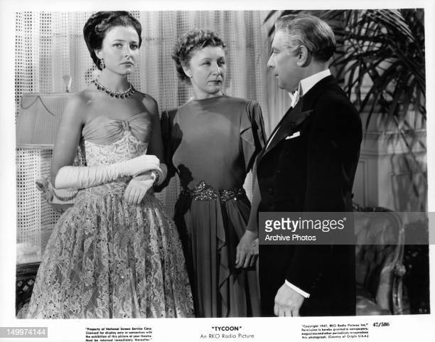 Laraine Day looking away as Judith Anderson and Cedric Hardwicke stare at each other in a scene from the film 'Tycoon' 1947
