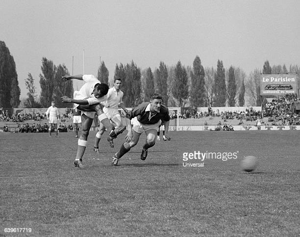 Larbi Ben Barek of Marseille and Eloy of Sedan during a French Cup quarterfinals match Marseille vs Sedan