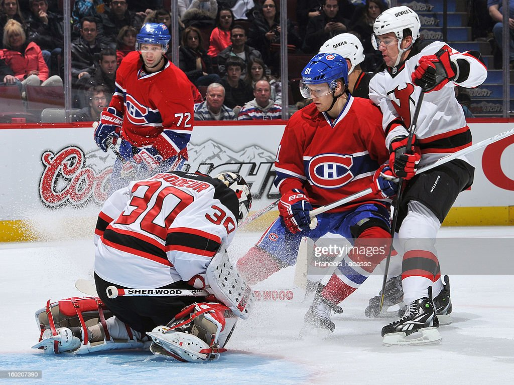 Larc Eller #81 of the Montreal Canadiens looks for a loose puck in front of goalie Martin Brodeur #30 of the New Jersey Devils as during the NHL game on January 27, 2013 at the Bell Centre in Montreal, Quebec, Canada.
