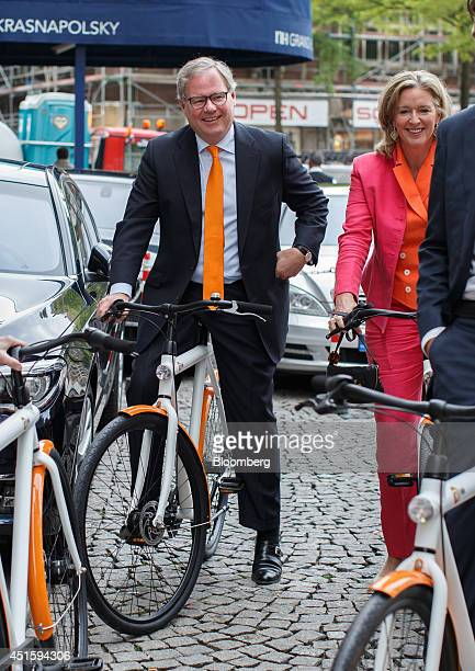 Lard Friese chief executive officer of NN Group NV left and Dorothee van Vredenburch member of the management board of ING Groep NV arrive on...