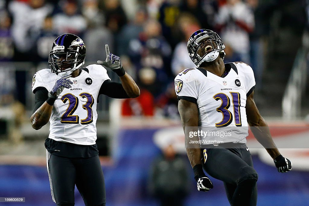 Lardarius Webb #21 and Bernard Pollard #31 of the Baltimore Ravens celebrate a fumble recovery against Stevan Ridley #22 of the New England Patriots in the fourth quarter during the 2013 AFC Championship game at Gillette Stadium on January 20, 2013 in Foxboro, Massachusetts.