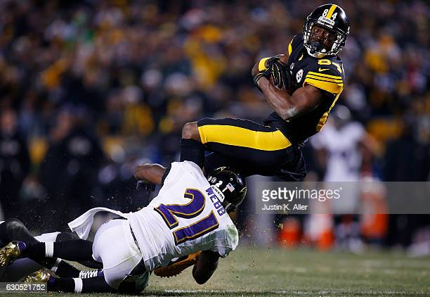 Lardarius Webb of the Baltimore Ravens attempts to tackle Antonio Brown of the Pittsburgh Steelers in the second half during the game at Heinz Field...