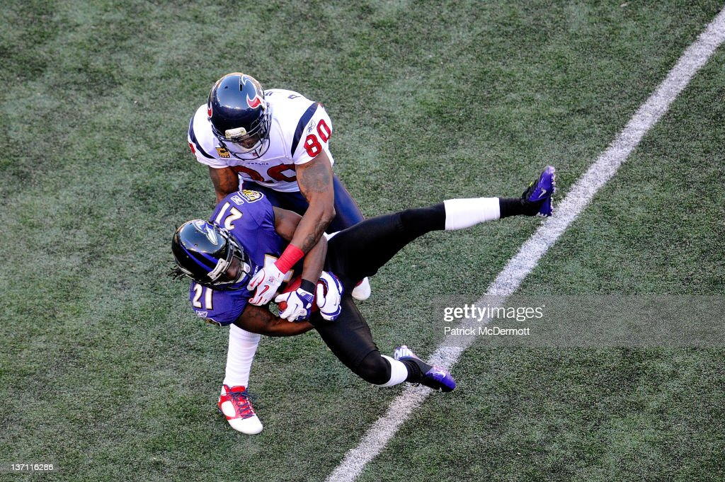 <a gi-track='captionPersonalityLinkClicked' href=/galleries/search?phrase=Lardarius+Webb&family=editorial&specificpeople=5735454 ng-click='$event.stopPropagation()'>Lardarius Webb</a> #21 of the Baltimore Ravens intercepts a pass intended for Andre Johnson #80 of the Houston Texans during the first half of the AFC Divisional playoff game at M&T Bank Stadium on January 15, 2012 in Baltimore, Maryland.