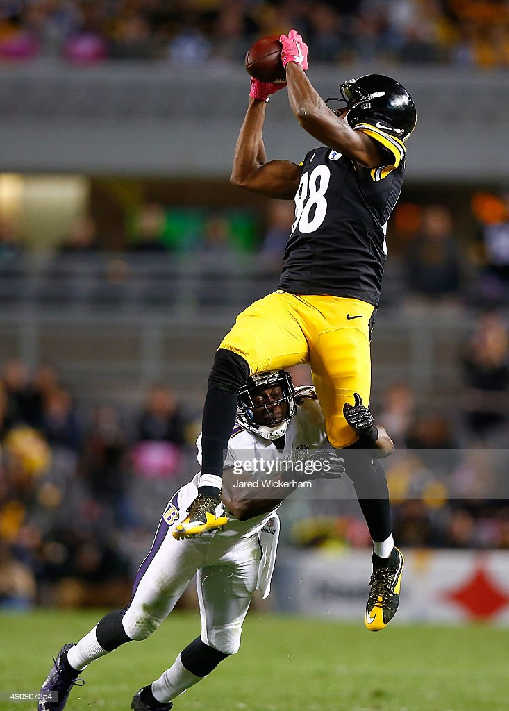 <a gi-track='captionPersonalityLinkClicked' href=/galleries/search?phrase=Lardarius+Webb&family=editorial&specificpeople=5735454 ng-click='$event.stopPropagation()'>Lardarius Webb</a> #21 of the Baltimore Ravens tackles <a gi-track='captionPersonalityLinkClicked' href=/galleries/search?phrase=Darrius+Heyward-Bey&family=editorial&specificpeople=4018192 ng-click='$event.stopPropagation()'>Darrius Heyward-Bey</a> #88 of the Pittsburgh Steelers after making a catch in the 4th quarter of the game at Heinz Field on October 1, 2015 in Pittsburgh, Pennsylvania.