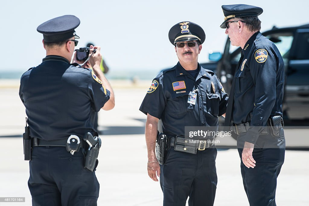 Laredo Police Officers take a picture together before the arrival of Republican Presidential candidate and business mogul Donald Trump during his...