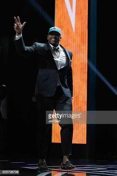 Laremy Tunsil of Ole Miss walks on stage after being picked overall by the Miami Dolphins during the first round of the 2016 NFL Draft at the...