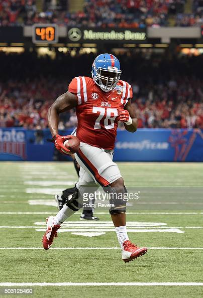 Laremy Tunsil of the Mississippi Rebels scores runs in a touchdown during the second quarter against the Oklahoma State Cowboys in the Allstate Sugar...