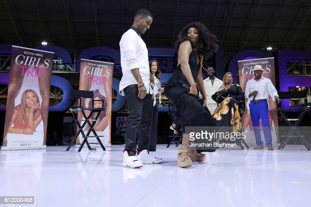 Larenz Tate and Tiffany Haddish from the movie Girls Trip dance during the Essence Music Festival at the Ernest N Morial Convention Center on July 1...