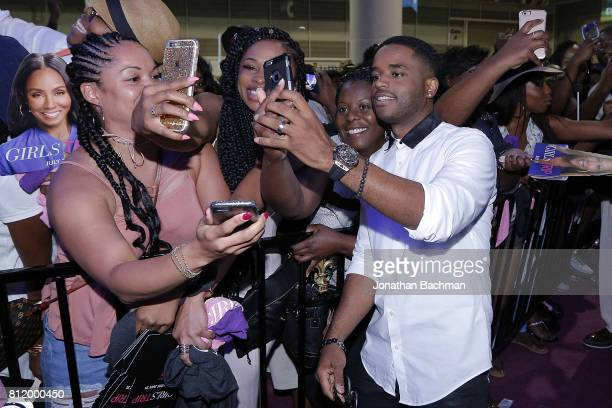 Larenz Tate from the movie Girls Trip takes photos with fans during the Essence Music Festival at the Ernest N Morial Convention Center on July 1...