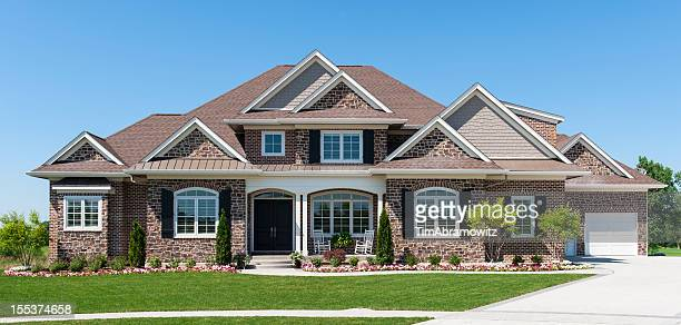 Large American detached home with garden and blue sky