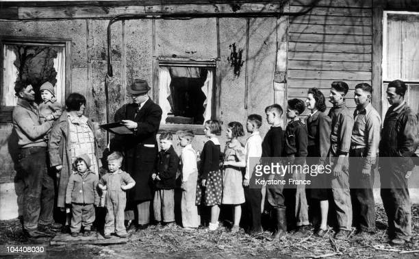 A large American family in a suburb of Chicago during the visit of a census agent on April 3 1940