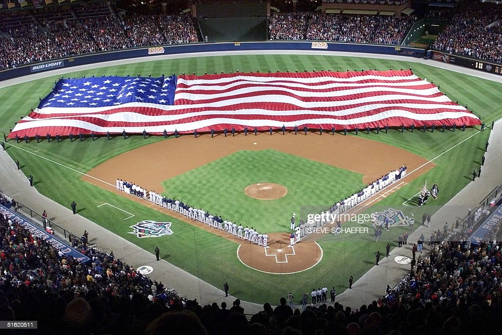 A large American flag covers Turner Field during the national anthem 23 October 1999 prior to game one of the 1999 World Series at Turner Field in...