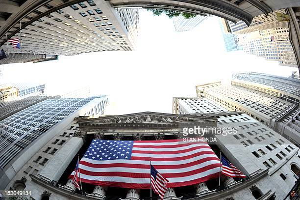 A large American flag draped across the front of the New York Stock Exchange August 5 2011The Dow Jones Industrial Average fell 02 percent to 1136590...