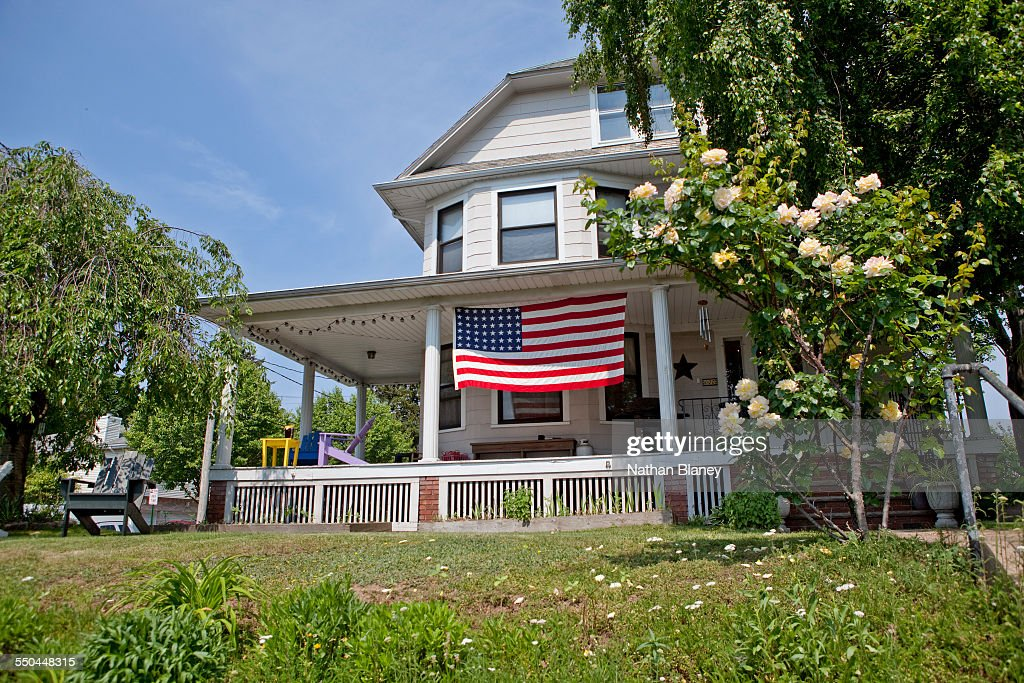A large American flag is displayed in front of this home in Carlstadt NJ May 2014