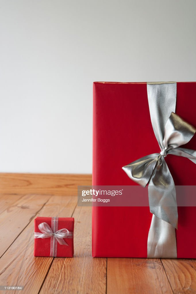 Large and small Christmas gifts on floor : Stock Photo