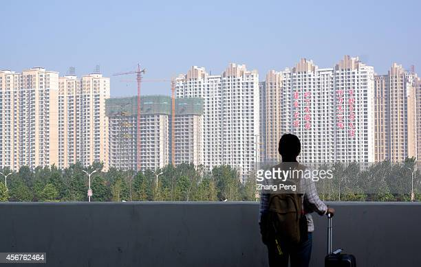 A large area of new apartment blocks have been built around the Luoyang Longmen High Speed Railway Station which was once rural farmland According to...