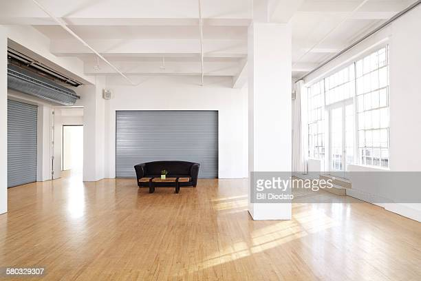 large bare room with couch