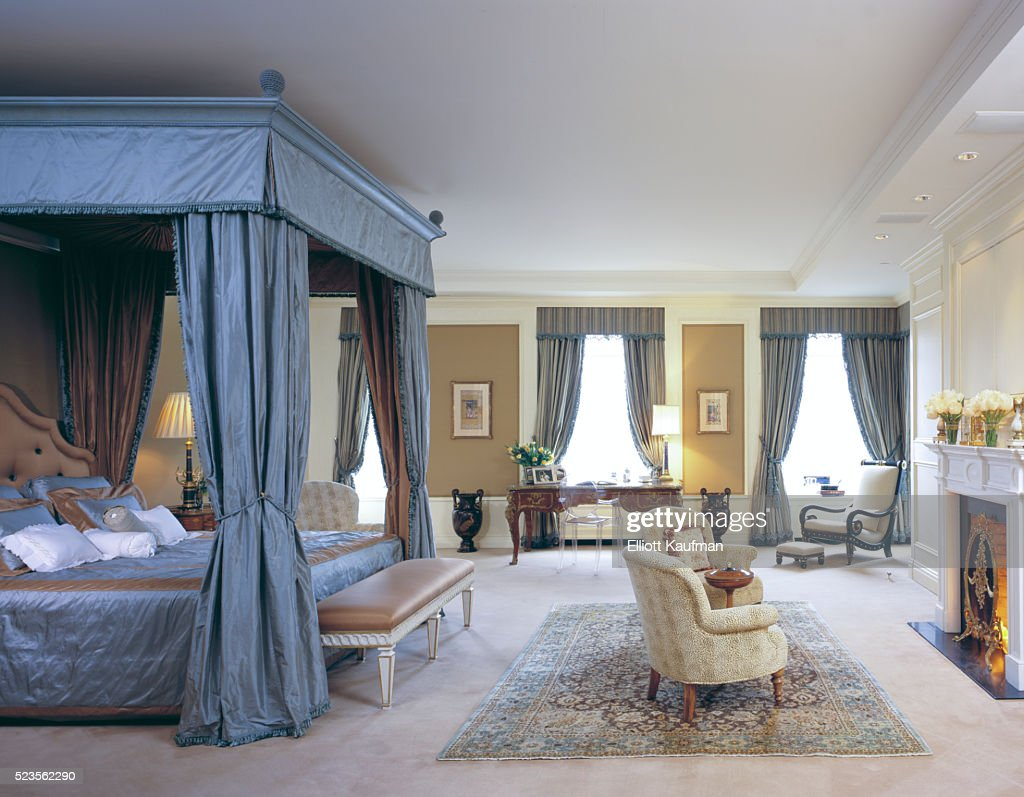 a large bedroom in a palatial apartment with canopy bed and