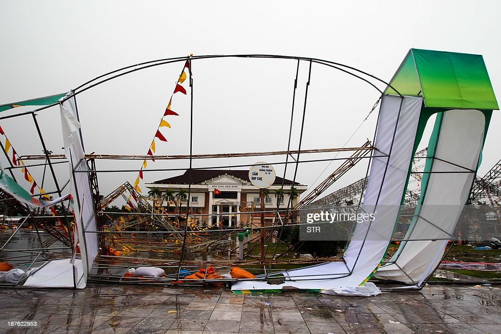 A large billboard is seen torn down in north-eastern city of Thai Binh after the passage of the Tphoon Haiyan on November 11, 2013. Typhoon Haiyan made landfall in Vietnam early on November 11, uprooting trees and tearing the roofs off houses but without leaving a trail of death and devastation as in the Philippines. AFP PHOTO