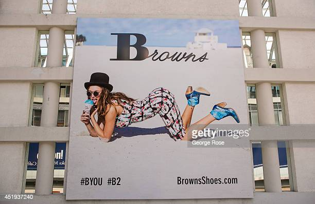 A large billboard promoting Browns Shoes hangs on a wall of the Eaton Centre shopping mall on June 28 2014 in Toronto Ontario Canada Canada's most...