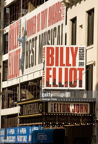 A large billboard promoting the 'Billy Elliot' Broadway musical is seen on the side of a parking structure in this 2009 New York NY early morning...