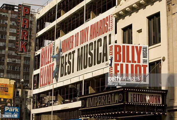 A large billboard promoting the 'Billy Elliot' musical is seen on the side of a parking structure in this 2009 New York NY early morning cityscape...