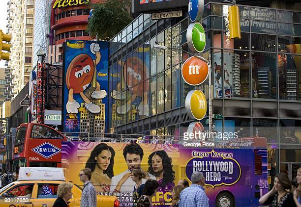 Large billboards promoting M M's chocolate candy greet visitors entering the Hershey's store on Broadway and 7th Ave as seen in this 2009 New York NY...