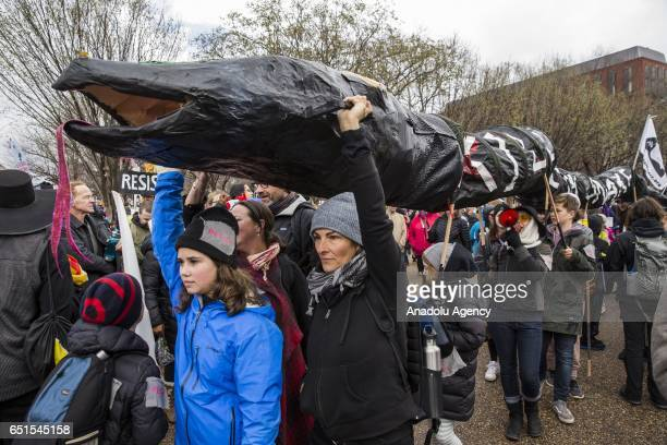 A large 'black snake' representing oil pipelines is carried in front of the White House by people protesting the construction of the Dakota Access...