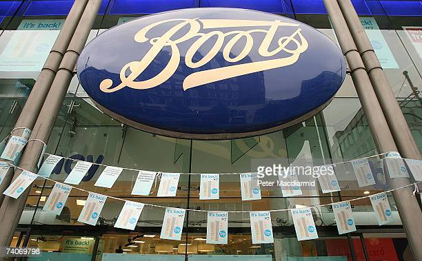 A large Boots the Chemist sign hangs over the fron entrance to their Oxford Street branch May 4 2007 in London Boots opened four of it's larger...
