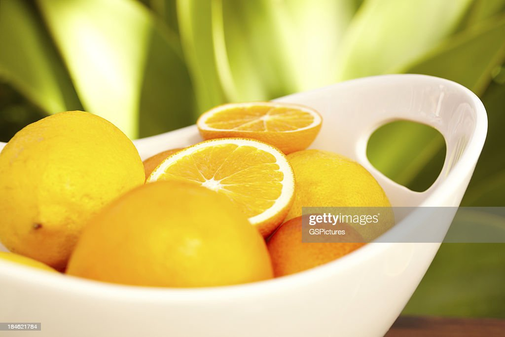 Large bowl of oranges outdoors at luxury spa