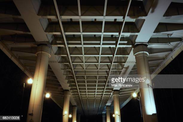 Large bridge building structures, bottom view at night