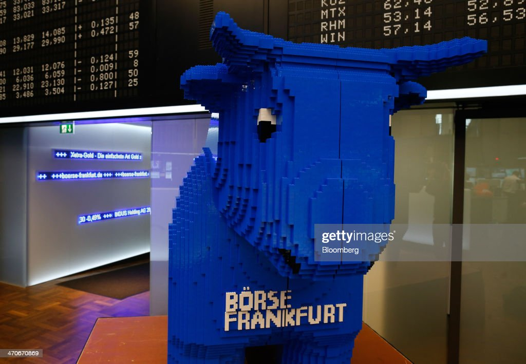 A large bull made of Lego stands on the trading floor of the Frankfurt Stock Exchange in Frankfurt, Germany, on Thursday, Feb. 20, 2014. Deutsche Boerse AG plans to set up a clearinghouse in Singapore to compete with Singapore Exchange Ltd. and IntercontinentalExchange Group Inc. as the owner of the Frankfurt Stock Exchange and the Eurex futures market seeks to benefit from new financial regulations. Photographer: Ralph Orlowski/Bloomberg via Getty Images
