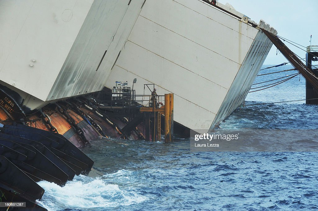 Large buoyancy tanks have been attached to the side of the stricken Costa Concordia as the parbuckling project to upright the ship is set begin, on September 15, 2013 in Isola del Giglio, Italy. The Costa Concordia is reportedly due to be righted beginning on the morning of September 16, then, if the operation is successful, it will be towed away and scrapped.